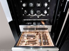 The Man Safe reinvents what a safe can be, and more importantly, how you can make use of it. Watch box, large safe with humidor and storage for cigar accessories, watch winders, drawers, in Jet Black with black Ultrasuede and carbon fiber accents.