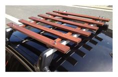 Red Oak roof rack. Uses Thule T-shaped bolts and wing nuts to secure to base rack bars.