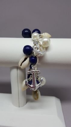 Silver Anchor Charm Bracelet with Navy Beads  Anchors, shells, and navy beads adorn this adjustable rope bracelet. Easy to put on and off.  Shop: https://www.shoppinwithsailin.com/collections/bracelets/products/silver-anchor-charm-bracelet-with-navy-beads?utm_content=bufferd68cb&utm_medium=social&utm_source=pinterest.com&utm_campaign=buffer  Size: Charms are attached to extendable rope to fit all sizes Also available in Gold FREE SHIPPING!!!