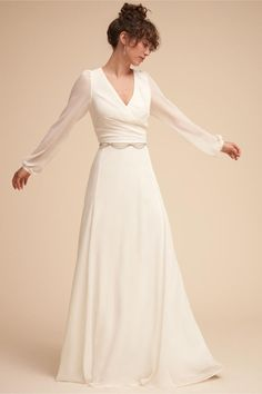 This dress brings an understated drama with billowing cuffed sleeves on a plunging surplice bodice. Covered buttons run down the sheer back, giving way to an airy chiffon skirt Nova Dress - UNDER $500  #wedding #weddinggown #ad
