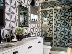 The guest bathroom at #HGTVUrbanOasis makes a bold geometric statement. With brass accents and beautiful ceramic tiles, it could be our favorite room in the whole house. Want to win this home? Enter at the link in our bio!  NO PURCHASE NECESSARY. Ends 11/22. To enter and for complete details visit HGTV.com/UrbanOasis