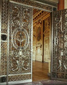 BAROQUE ARTS & CRAFTS 17TH CENTURY   Doors of the Galerie d'Apollon, 1650 - wrought iron and silver. From the Chateau de Maisons   Louvre, Departement des Objets d'Art, Paris, France