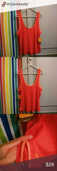 Lucy Coral Pink Orange Athletic Tank top Bright & fun coral pink w/ orange trim athletic tank top by Lucy. This is called the 'daily practice tank.' Lightweight/semi-sheer Lucy tech moisture wicking fabric. Size medium. Fits true to size. Brand new never worn with tag. Minor wrinkling due to nature of the fabric & being folded. Perfect for spring & summer..! : ) {No trades} [11702] Lucy Tops Tank Tops