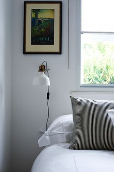 Ranarp lamp by Ikea in guest bedroom of Isabel and George Blunden London renovation | Remodelista