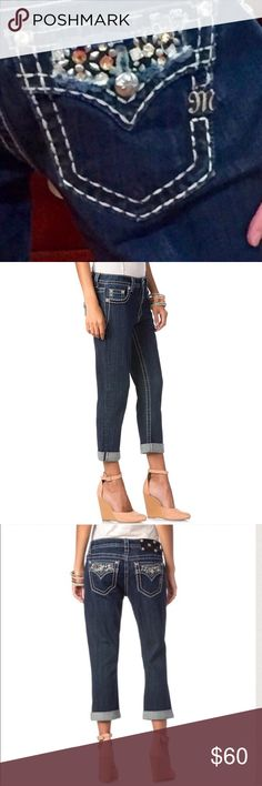 """Mixed Crystal Boyfriend Miss Me Capris Dark wash denim boyfriend cuffed capri with contrast stitching will make you look and feel like a million bucks while still secretly being comfy the whole time!! A mix of studs &bronze and clear crystals mix in a combination that really POPS to add that WOW factor that we all know and LOVE from Miss Me! Boyfriend Cut Fits almost a Size Larger than Traditional Miss Me Stylesmanual measurements laying flat unstretched: Waist 15.5"""" Hips 22"""" Upper Thigh…"""