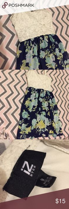 Iz buyer dress Bought from kohls. Has a little padding, and also zips in the back. Top part is white lace but heavier material, and bottom is floral silky material with a heavier navy blue material underneath. Iz Byer Dresses