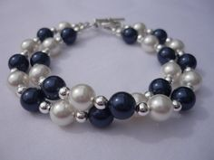 Midnight blue and white Swarovski pearls in a double strand bracelet.  Highlighted with sterling silver beads.