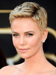 Charlize Theron looked stunning in her gorgeous white gown and short new hairdo at the 2013 Oscars. She finished her look with a classic pair of diamond stud earrings - the perfect touch.
