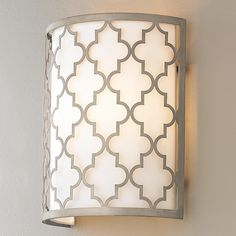 This Moroccan pattern. It's not that I don't like it, I just don't want it because it's just everywhere - rugs, drapes, wall sconces. pillows. I'm already tired of it.  Contempo Arabesque Wall Sconce