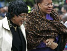 Former South African President Nelson Mandela's former wife, Winnie Madikizela-Mandela, left and his widow Graca Machel, right, walk together during the unveiling of a live size statue of Mandela at the Drakenstein Prison near Franschhoek, South Africa, Thursday, Aug. 21, 2008.