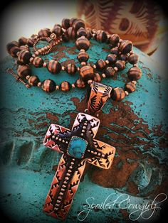 The focal of this Amazing necklace is the rustic handmade Cross pendant! It is made from 20 gauge Recycled Copper Metal. A 12mm Navada Blue