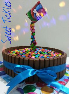 A gravity defying cake for a birthday boy. its a chocolate truffle cake loaded with gems n kitkat.