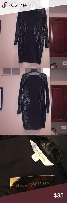 Nicki Minaj Black dress Fit to body black Nicki Minaj dress. Mesh long sleeves. Body is solid black with skinny leopard print down both sides. About knee length Nicki Minaj Dresses Midi