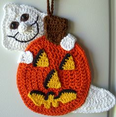 Crochet pumpkin and ghost, by Jerre Lollman  This is easier to store than a wreath or pumpkin.