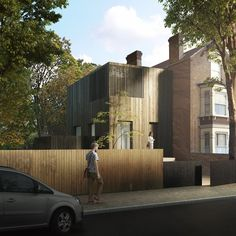 Adjaye Associates has created a timber-clad two-storey house that could be added to a typical London terrace.
