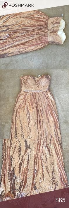 """Rose gold sequin gown Rose gold sequin floor length, strapless gown. Used once as a bridesmaid dress for my wedding. Custom made by an Etsy shop. Has inner belt to inside dress for added support. Size 16, but it runs small - it fits more like a 14 so I listed it as that size. The dress was originally really long so it has been altered to fit a 5.3"""" frame with 2.5"""" shoes. It still has extra length shown in reference photos. custom Dresses Strapless"""