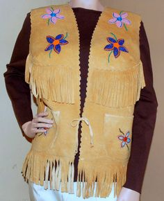 Vintage beaded vest is great looking smoked moose suede of the Pacific Northwest, with scalloped edge and fringe.  Find this at luckystargallery.com $225
