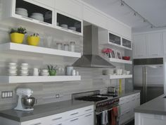 Contemporary white and gray kitchen with open shelves. #whitekitchen #contemporary #interiordesign