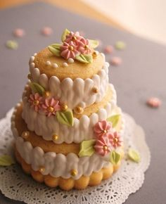Mini wedding cake made out of sugar cookies. Like how the icing covers the cookie sides.