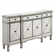 This finely handcrafted 3 drawer, 4 door mirrored cabinet from the Danville collection will be the statement piece in your home. The expert workmanship is evident in the details from top to bottom.
