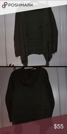 Free People jacket Soft material, cardigan-esqe but a little thicker.  Definitely a good layer in the winter and adequate for the spring and fall. Giant pockets. Frayed bottom. Free People runs big! So as a medium it fit me well, but would also work for someone who typically wears a small. A tad lighter than photographed. Olive green!  One of my favorites. Free People Jackets & Coats