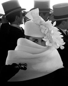 A Givenchy hat photographed by Frank Horvat, 1958. This model looks an awful lot like Audrey Hepburn, and if she isn't Audrey Hepburn, then she is doing a remarkably good midcentury-My-Fair-Lady job of it. The gents in top hats don't hurt. ;p