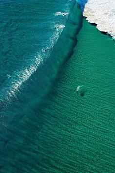 The Surfer's Journal~ look at the size of the wave compared to the size of the jetski~WOW!!!