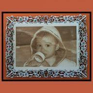Simona: Engraving photo on frame.