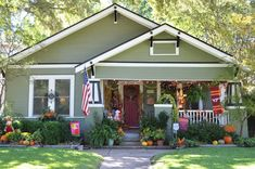 Breathtaking Red Door decorating ideas for Charming Exterior Craftsman design ideas with american flag bungalow covered porch front porch gable roof green house green