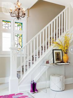 bright entry with Lucite console table (I love the mix of modern decor in an a craftsman style home)