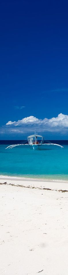 Outrigger fishing boat and Caribbean blue water
