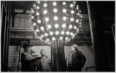 After four years of New Year's Eve fireworks celebrations, Adolph Ochs wanted a bigger spectacle at the building to draw more attention to the newly-renamed Times Square. An electrician was hired to construct a lighted Ball to be lowered from the flagpole on the roof of One Times Square. The iron Ball was only 5 feet in diameter! The very first drop was on New Year's Eve 1907, one second after midnight.
