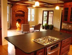 Love the fireplace in the kitchen. Truly turns the kitchen into a family room.