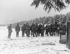 New Year's Eve in the Bulge. Here, men of the 99th Infantry Division listen to a Christian service