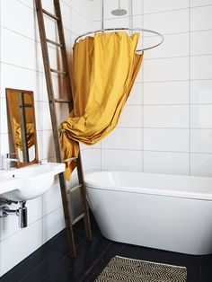 Shower curtain made by Trudy with fabric from The Fabric Shop in Fitzroy.  Antique Danish mirror.  Kaldewei Bath from Bathe Australia.  Vintage ladder from Sedonia in Seddon.  Photo - Eve Wilson, production – Lucy Feagins / The Design Files