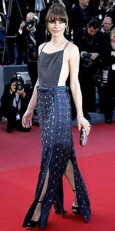 MILLA JOVOVICH The supermodel veers dangerously close to a wardrobe malfunction in this Prada gown consisting of a black silk top and navy skirt with gemstone detailing at the premiere of Cleopatra.2013 Cannes Film Festival