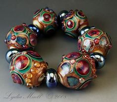 """""""Treasury Jewels"""" bead set by Lydia Muell. Sold."""