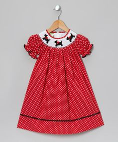 A sprinkling of polka dots and dollop of rickrack trim give this crisp-to-the-touch frock sugary sweet flair. Thanks to the buttons in back, it pulls on as swiftly as a glide across Rainbow Trail!65% polyester / 35% cottonMachine wash; tumble dryImported