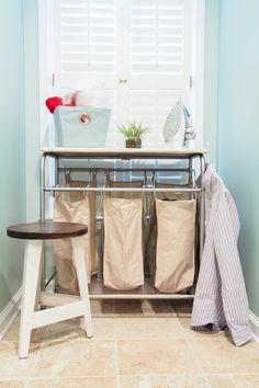 Maybe something like this solves my laundry cart and folding area dilemma.  Traditional Laundry Room by Redbud Construction Services