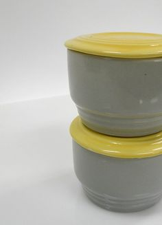 Two Gray and Yellow GE - Hall Regrigerator Dishes