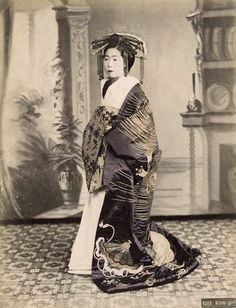 Tayuu, the highest class of courtesan. Hand-colored photo, about 1880's, Kyoto, Japan. Image via Sgt Steiner of Flickr