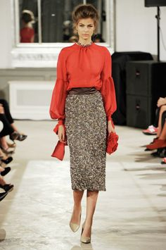These are designer clothes, but the idea translates well: a classic blouse (colored or ivory) with a tweedy pencil skirt, belt and classic pumps. These are achievable at a lot of price points or through eBay or thrift shops. By Jesper Høvring S/S 2013