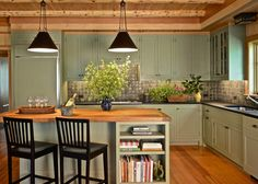 """The kitchen cabinetry in this lakeside home is painted in Farrow & Ball's """"Lichen"""" and the pendant lights are by Paul Ferrante on blog.wellappointedhouse.com"""