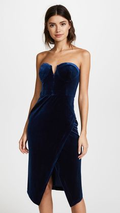 Yumi Kim Velour Allure Dress Luxe velvet and a sleek strapless silhouette gives our Velvet Allure Dress a glamorous feel. Details include a bustier bodice with split v-neckline, mid-length crossover skirt, and exposed center back zipper. Affiliate link