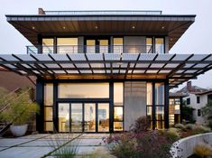 fabulpus energy saving home design with flat roof design idea then wide glass window then wooden ceiling design idea with small lightng ceiling at terrace.