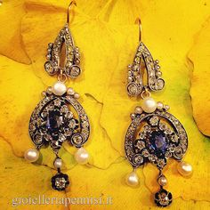 A pair of silver topped, yellow gold, diamond, sapphire and natural pearl chandelier earrings. France, 1850 circa.