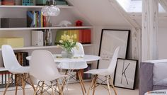 A slanted ceiling gives even the most cramped space an almost ethereal feel. Eames Dining Chair, Dining Table, Angled Ceilings, Slanted Ceiling, Dining Room Inspiration, Take A Seat, 3 D, Mid-century Modern, House Design