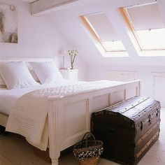 Attic bedroom. Oooh. I wish my bedroom, built from a former attic, had windows just like this.
