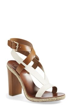 Head over heels for these gorgeous gorgeous Tory Burch sandals! Wear them with flare jeans for an on trend look.