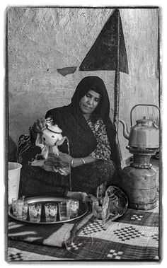 Morocco 1997-  A Berber Home in the Desert - Umm Ali  pours tea from a small, chipped enamel tea pot. These are the favorite tea pots for family use http://www.rosemarysheel.com/archives/morocco-tea